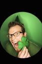 Royalty Free Photo of a Vignette of a Man Wearing a Saint Patrick's Day Hat and Holding a Shamrock