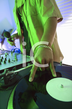Royalty Free Photo of a DJ's Hand Spinning a Vinyl Record