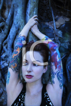 Royalty Free Photo of a Tattooed Woman With a Banyan Tree in Maui, Hawaii, USA