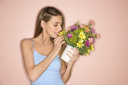 Royalty Free Photo of a Woman Holding a Pot of Flowers