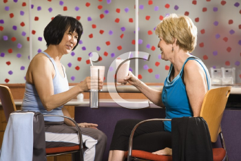 Royalty Free Photo of Older Women Sitting at a Table in a Health Club Cafeteria