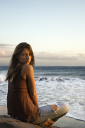 Royalty Free Photo of a Woman Sitting on a Beach in Maui Hawaii