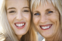 Royalty Free Photo of a Mother and Daughter Smiling and Laughing