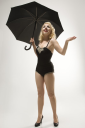 Royalty Free Photo of a Woman Wearing a Retro Swimsuit in a Pinup Pose With an Umbrella