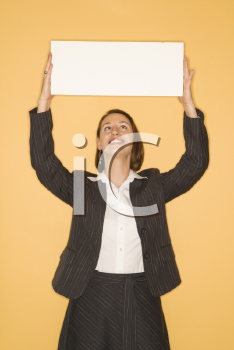 Royalty Free Photo of a Businesswoman Holding Up a Sign