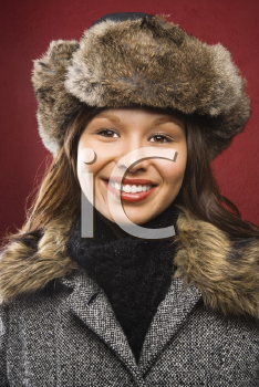 Royalty Free Photo of a Young Woman Wearing a Fur Hat Smiling