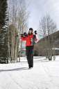 Royalty Free Photo of Teenager Walking and Carrying Ski Gear