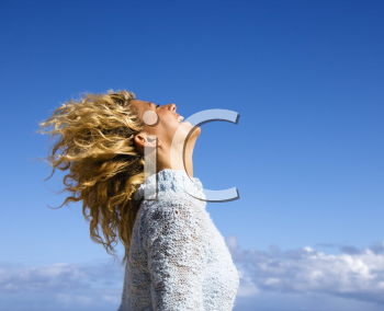 Royalty Free Photo of a Side View of a Pretty Woman Holding Her Head Back and Smiling