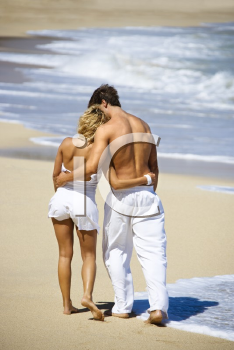 Royalty Free Photo of an Attractive Couple Walking on Maui, Hawaii Beach With Arms Around Each Other