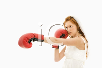 Royalty Free Photo of a Bride Wearing Boxing Gloves
