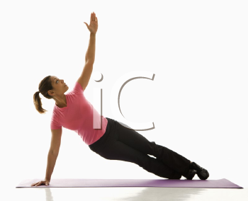 Royalty Free Photo of a Woman Holding a Yoga Pose and Stretching