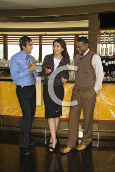 Royalty Free Photo of Diverse Friends at a Bar Drinking