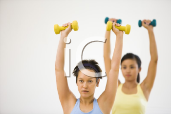 Royalty Free Photo of Young Women Lifting Dumbbell Weights