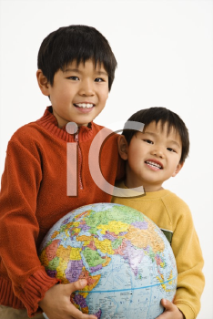 Royalty Free Photo of Two Boys Holding a World Globe and Smiling