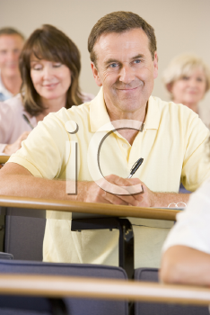 Royalty Free Photo of a Man Listening in a Class
