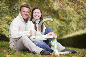 Royalty Free Photo of a Couple Sitting Outside