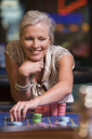 Royalty Free Photo of a Woman at a Roulette Table