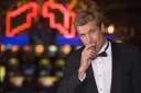 Royalty Free Photo of a Man in a Casino With a Cigar