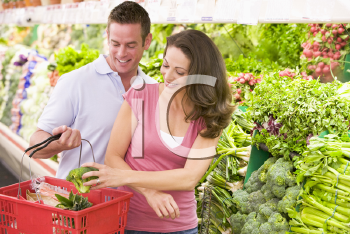 Royalty Free Photo of a Couple Shopping in a Grocery Store