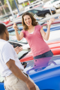 Royalty Free Photo of a Woman Getting the Keys for a New Car