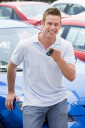 Royalty Free Photo of a Guy With the Keys to a New Car
