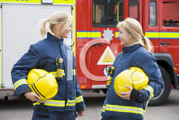 Royalty Free Photo of Two Female Firefighters Talking