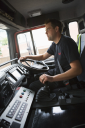Royalty Free Photo of a Firefighter Driving the Truck