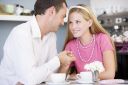 Royalty Free Photo of a Young Couple Having Tea