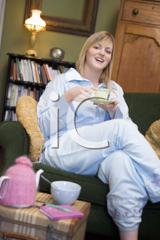 Royalty Free Photo of a Young Woman Drinking Tea