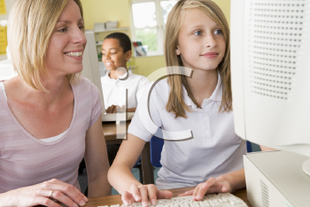 Royalty Free Photo of a Student and Teacher at a Computer Terminal