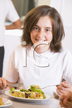 Royalty Free Photo of a Girl in a Cafeteria