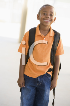 Royalty Free Photo of a Boy With a Backpack