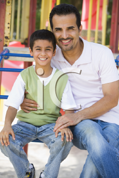 Royalty Free Photo of a Father and Son at the Playground