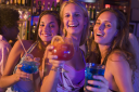 Royalty Free Photo of Young Women in a Bar