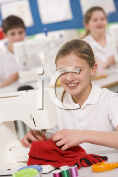 Royalty Free Photo of a Girl Sewing