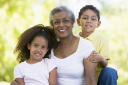 Royalty Free Photo of a Grandmother With Her Grandchildren