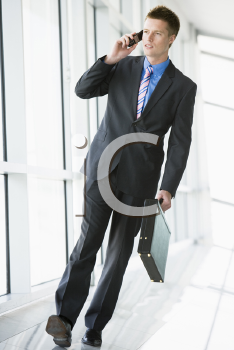 Royalty Free Photo of a Man Talking on a Cellphone