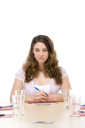 Royalty Free Photo of a Woman Sitting in a Board Room