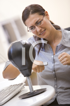 Royalty Free Photo of a Woman Punching a Bag
