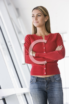 Royalty Free Photo of a Young Woman in a Corridor