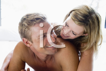 Royalty Free Photo of a Couple in Bed
