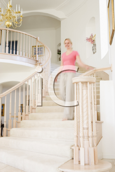 Royalty Free Photo of a Woman Coming Down a Staircase