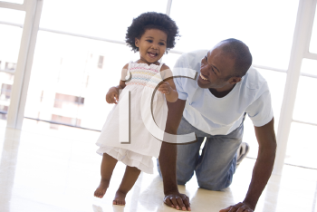 Royalty Free Photo of a Father and Daughter Playing on the Floor