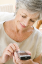 Royalty Free Photo of a Woman Sending a Text Message
