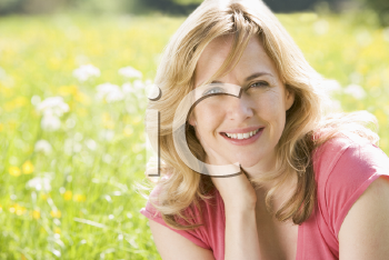 Royalty Free Photo of a Woman in a Field of Flowers