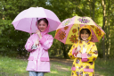 Royalty Free Photo of Two Girls With Umbrellas