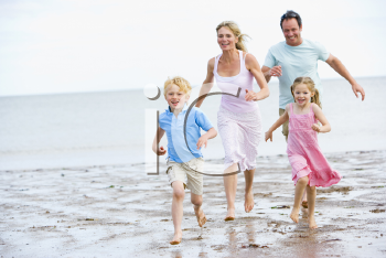 Royalty Free Photo of a Family Running at the Beach