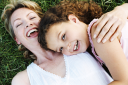 Royalty Free Photo of a Mother and Daughter on the Lawn