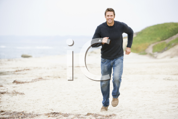 Royalty Free Photo of a Man Running on the Beach