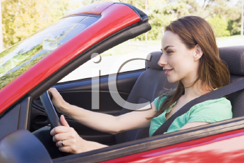 Royalty Free Photo of a Woman in a Convertible